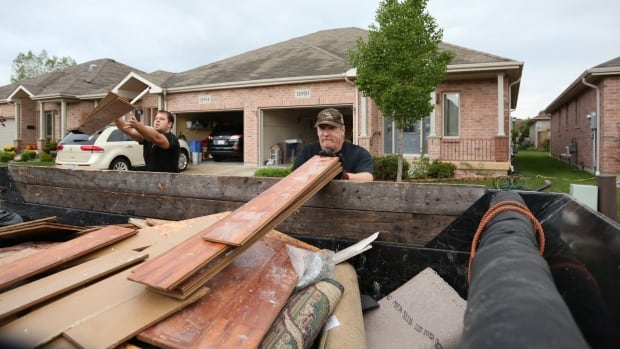 Cleanup crews were busy throughout Windsor and Tecumseh, Ont., Saturday as residents continue to recover from severe flooding that hit the region earlier in the week.