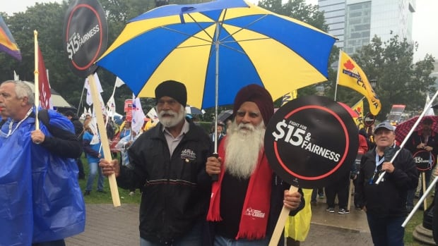 Thousands gathered at Queen's Park as part of the Rally for Decent Work on Saturday.