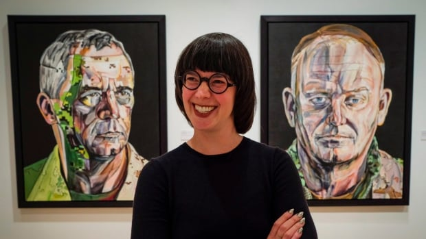 Lindsey Sharman, curator of the University of Calgary' Founders' Gallery, at the Military Museums, with some of Gertrude Kearns art work in the The Art of Command exhibit at the museum in Calgary on Thursday.
