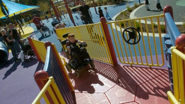 In this photo a 6-year-old boy in a wheelchair uses an adapted park similar to the one being built in Verdun for June, 2017.