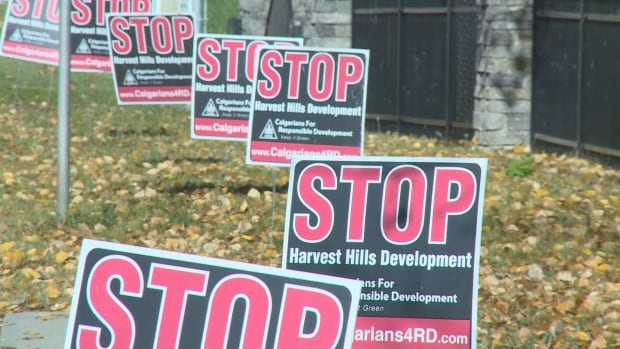 Signs mark residents' opposition to the rezoning of Harvest Hills Golf Course to make way for a housing development.