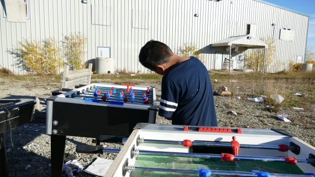A boy plays table soccer in Shamattawa First Nation in Sept. 2016.