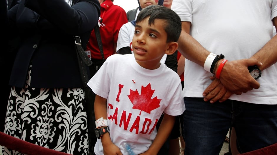 A Syrian refugee waits to shake hands with the Prime Minister on Canada Day, 2016. Journalist Anita Li argues Canadians have a smug attitude about multiculturalism in Canada, and says the media help maintain it by not speaking openly and frankly about race.