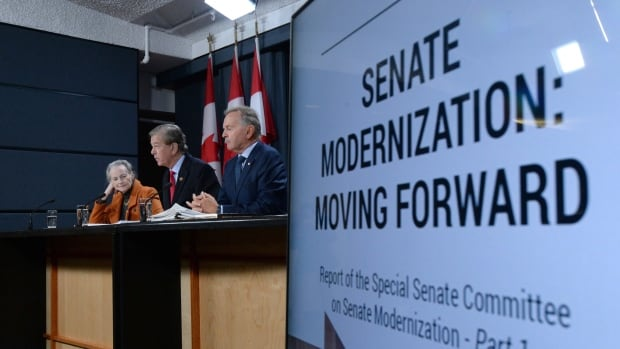 Senator Thomas Johnson McInnis, right to left, Senator Serge Joyal, and Senator Elaine McCoy present the Senate committee on modernization's report, which recommends televising chamber proceedings and altering committee membership.