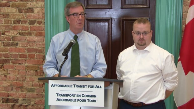Ottawa Mayor Jim Watson (left) and transit commission chair Stephen Blais take questions after announcing a new low-income transit pass will be introduced in early 2017.
