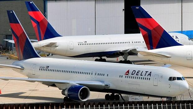 Delta Air Lines planes 2010 file Mark Lennihan/AP File Photo