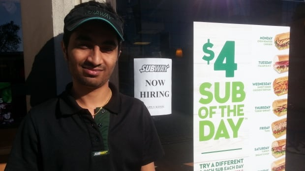 Keyur Morthana earns minimum wage but says he survives big-city prices by working seven days a week.
