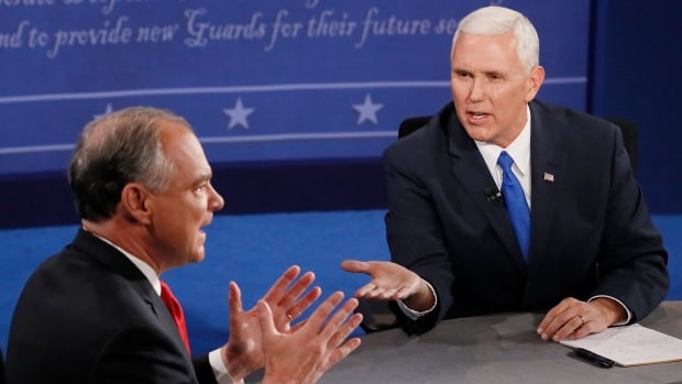 Republican vice-presidential nominee Gov. Mike Pence, right, and Democratic vice-presidential nominee Sen. Tim Kaine speak during the vice-presidential debate at Longwood University in Farmville, Va., on Tuesday.