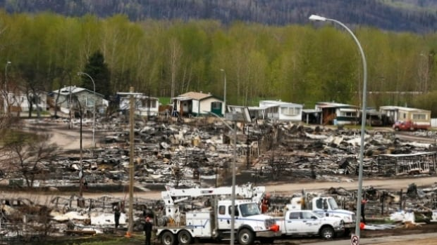 Crews begin to work on the burned remains of the Waterways neighbourhood of Fort McMurray, where 238 properties were destroyed.