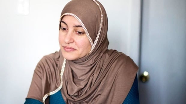 A disciplinary investigation into the conduct of a judge who ordered Rania El-Alloul to remove her hijab before she would hear El-Alloul's case is now on hold.