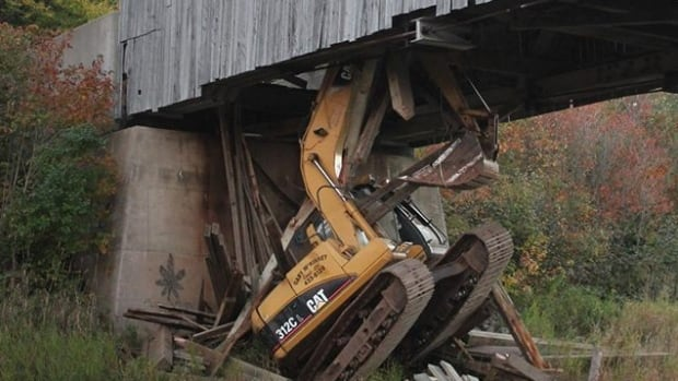 An excavator went through the deck of the Hammond River No. 2 covered bridge in French Village on Oct. 5, 2016.