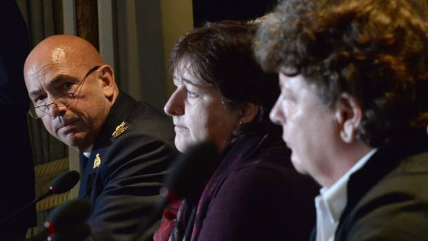 RCMP commissioner Bob Paulson, left, answers a question during a news conference, as plaintiffs Janet Merlo, centre, and Linda Davidson look on, in Ottawa Thursday, Oct. 6, 2016. Paulson has apologized to hundreds of current and former female officers and employees for alleged incidents of bullying, discrimination and harassment.