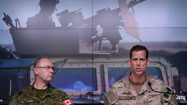 Lt.-Gen. Stephen Bowes, left, and Brig.-Gen. Peter Dawe speak as the Canadian Armed Forces provides an update on Operation Impact in the Middle East during a press conference at National Defence headquarters in Ottawa on Thursday.