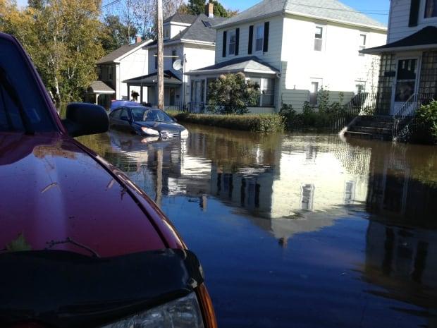 Flooded car St. Peters Road, Sydney, Nova Scotia