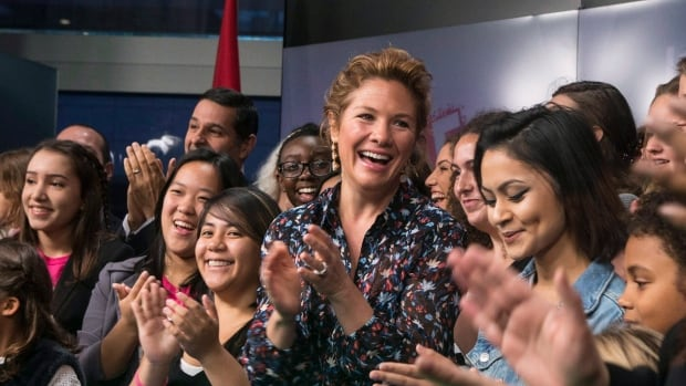 Sophie Grégoire Trudeau, centre, stands with girls representing G(irls)20, FitSpirit, and Plan International Canada after opening the Toronto Stock Exchange Tuesday to celebrate International Day of the Girl.
