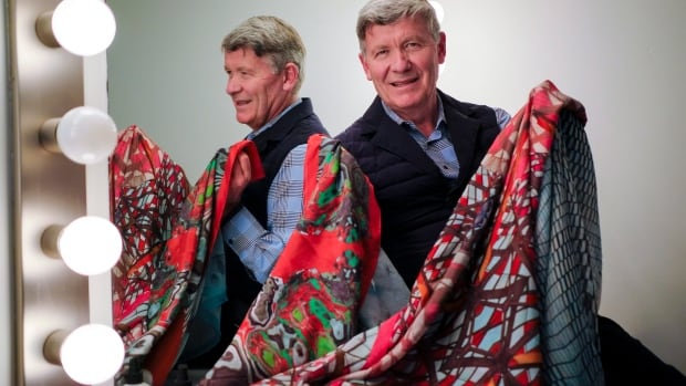Former oil and gas executive turned fashion designer, Jean-Michel Gires, displays his colourful scarves at a studio in Calgary, Alta., Thursday, Oct. 6, 2016.