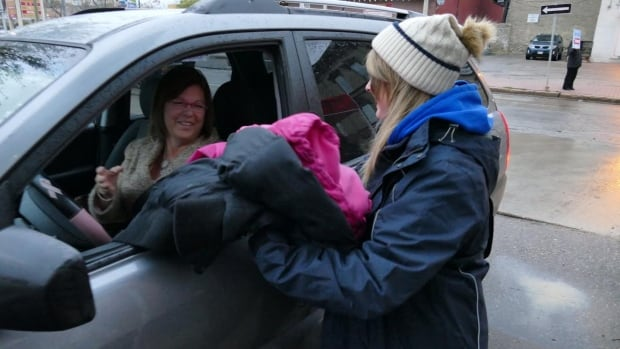 Volunteers accept winter clothing donations at the Koats for Kids kickoff on Wednesday morning in Winnipeg.