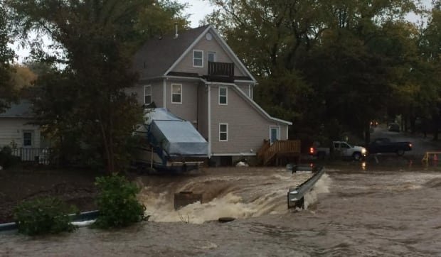 Water rushes into brook on Whitney Avenue