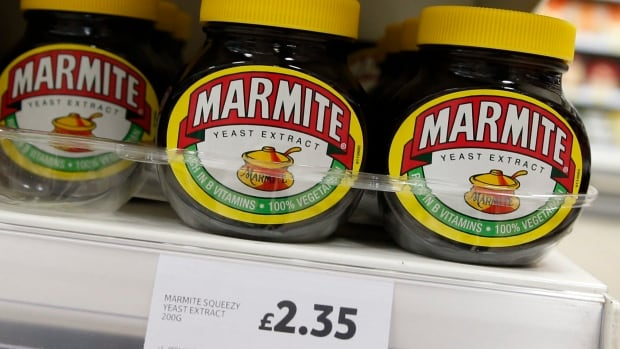 Jars of savoury spread Marmite, which is owned by the Anglo-Dutch multinational Unilever, on sale in a branch of Tesco in central  London, Thursday.