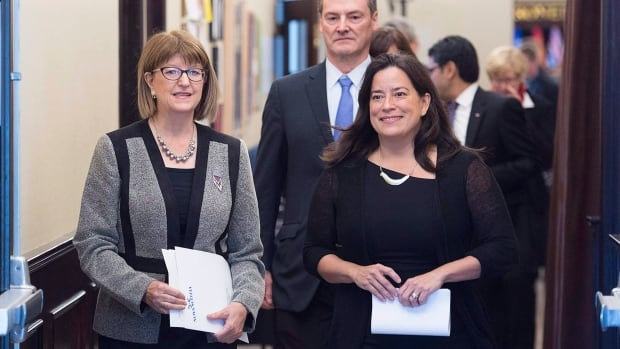 Nova Scotia Justice Minister Diana Whalen, left, and federal Justice Minister Jody Wilson-Raybould arrive at the closing news conference at a meeting of federal, provincial and territorial justice and public safety ministers in Halifax on Friday.