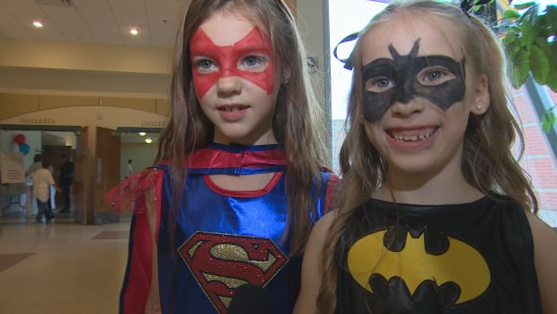 These two got to dress up as Superwoman and Batgirl Sunday at the Superhero Brunch in Winnipeg.