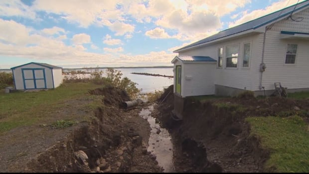 James Bates's home in Port Morien, N.S., is located beside a culvert that runs to the Atlantic Ocean.
