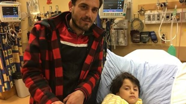 Douaa Sirhan of Haida Gwaii recovers from surgery at B.C. Children's hospital with the help of her father, Hassan Sirhan.