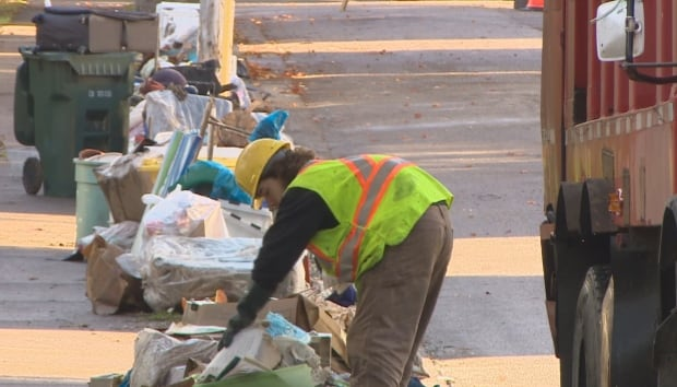 Garbage cleanup after flood CBRM