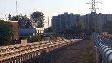 Residents cross over LRT tracks near Traynor Avenue Kitchener