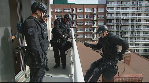 Ottawa police tactical officers participate in a training exercise in fall 2013. Police sources say staffing shortages within the unit are causing delays in the execution of search warrants.