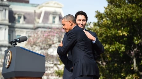 Obama Trudeau hug
