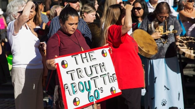 Sixties Scoop survivors and supporters gather for a demonstration at a Toronto courthouse last year. Scores of Indigenous people from across Ontario rallied in Toronto  ahead of a landmark court hearing on the so-called '60s Scoop.