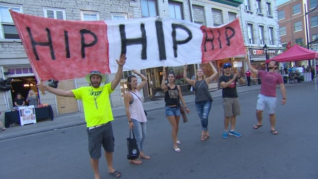 Fans excited to see Canadian rock legends The Tragically Hip in concert. (CBC)
