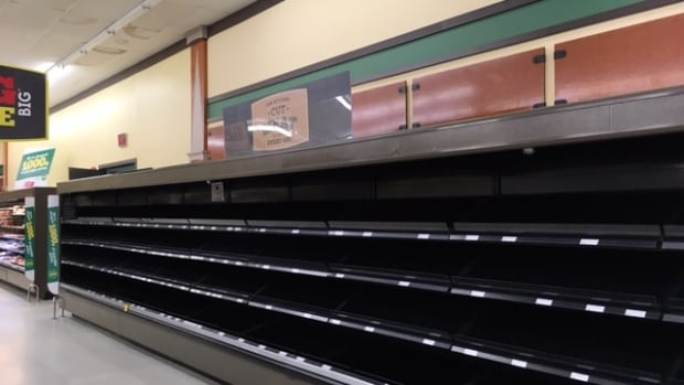 The shelves at the IGA store in the Opaskwayak Cree Nation are bare and the store's closing will throw 47 people out of work.