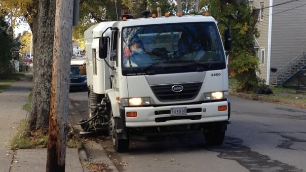 A street sweeper preps for the expected rainstorm in Sydney this weekend.