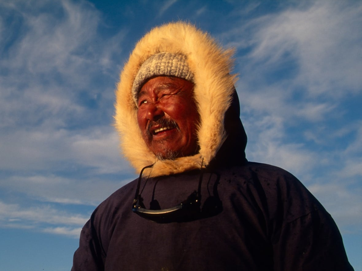 Ipeelie Koonoo scans the sea for narwhal and belugas at Cape Crawford, Baffin Island.