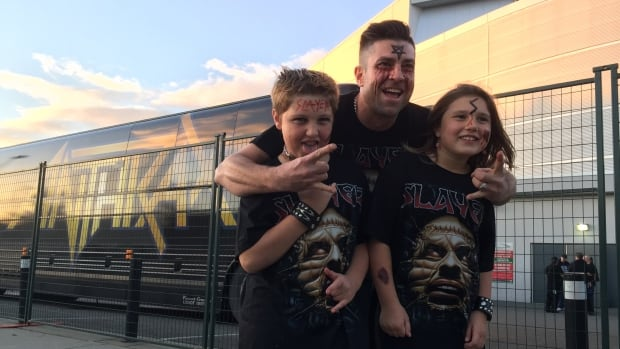 A whole family of Slayer fans outside a concert in Abbotsford, B.C., on Oct. 20. On the same day 30 years ago, the documentary Heavy Metal Parking Lot made its debut at a gallery in Washington, DC.