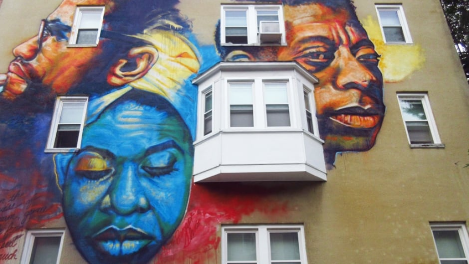 Artist Ernest Shaw's portrait of three civil rights icons: Nina Simone, James Baldwin and Malcolm X in east Baltimore