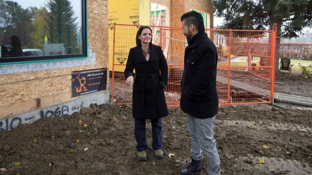 Minister of Municipal Affairs Danielle Larivee talks with Richard Nault from UrbanAge Homes about improved energy efficiencies in new home construction on Tuesday.