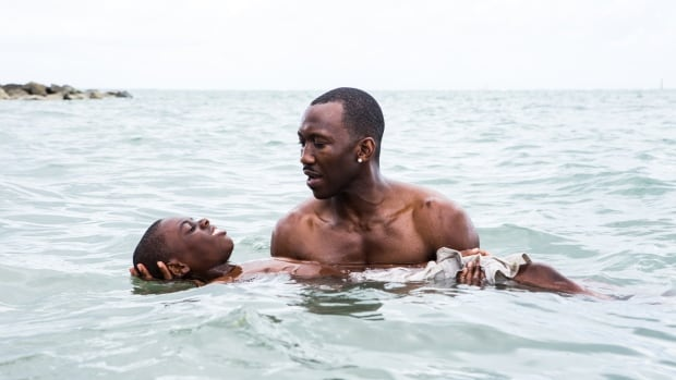 Alex Hibbert, left, and Mahershala Ali appear in a scene from Moonlight, directed by Barry Jenkins.
