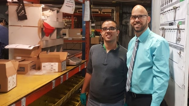 """Dylan Morin (left) says it's """"awesome"""" that his boss Greg Cruson is getting an award for hiring people with intellectual disabilities."""