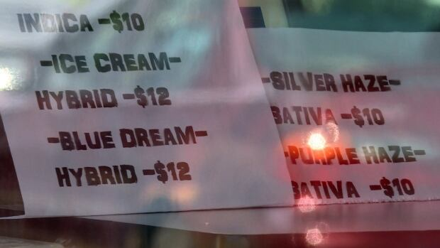 The only signage visible at a newly-opened dispensary on Innes Road on Tuesday were signs advertising different strains of marijuana.