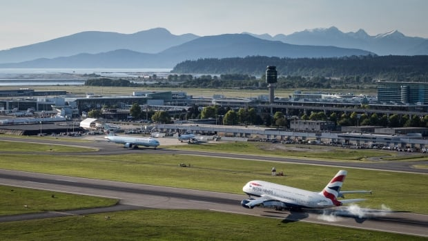 A plane touches down at YVR, recently named 'best airport in the world'.