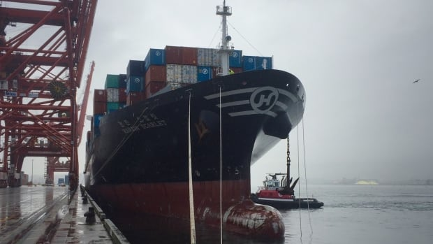 Hanjin Scarlet docks at the Port of Vancouver's shipping container terminal on Thursday. Crew from the Korean ship spent weeks of uncertainty aboard the vessel after Hanjin Shipping declared receivership in August.