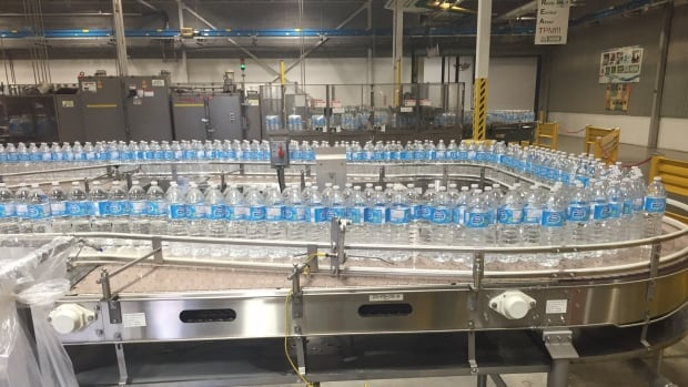 One-litre bottles of spring water move along an assembly line by the thousands inside Nestlé's Aberfoyle bottling plant, which is 12 kilometres from Guelph, Ont., city hall, where a meeting was held Monday night over water taking.