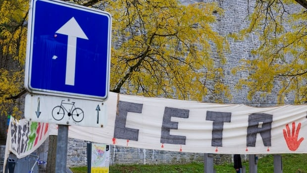A banner against CETA is displayed in front of the Walloon parliament in Namur, Belgium, on Friday. The European Union and Canada are closing in on a landmark free trade deal after Belgium cleared internal political opposition to the agreement.