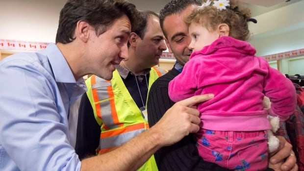 Canadian Prime Minister Justin Trudeau greets Syrian refugees at Pearson airport in Toronto back in December. A new CROP poll found a majority of Canadians were fine with Canada welcoming Syrian refugees into this country, but that we are divided on other subjects surrounding immigration.