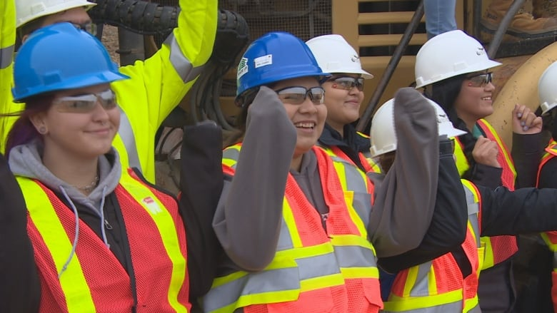 Regina girls try out heavy construction jobs at career event | CBC News
