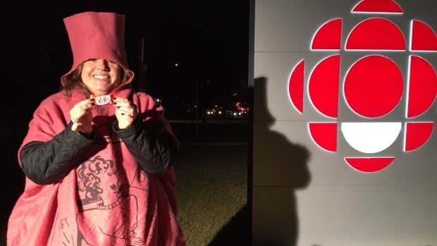 CBC Calgary traffic reporter Angela Knight hands out the winning treat in the Calgary Eyeopener candy survey the morning of Halloween.