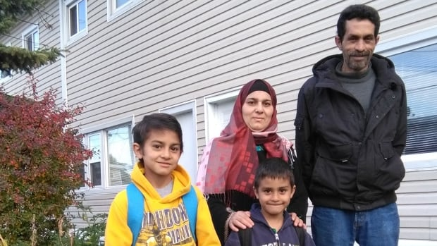 Haroun Al-Juhmani (far right), pictured here with his family in Calgary, spent decades growing crops in Syria and Cyprus.